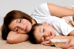 Sleeping mother with child