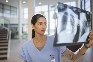 doctor-reviewing-xray-in-hospital