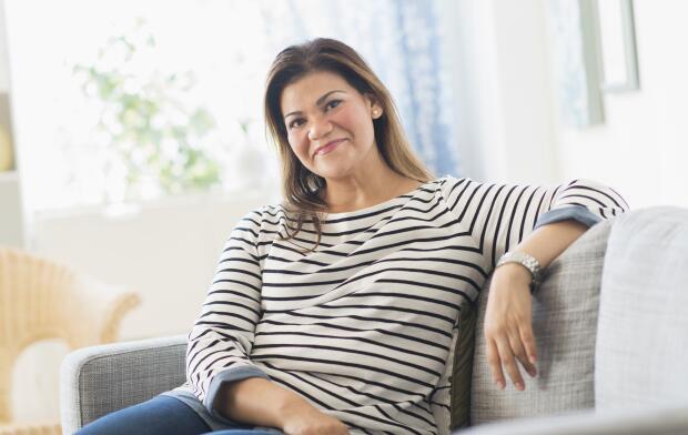 portrait-of-confident-woman-sitting-on-sofa