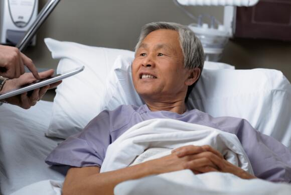 Asian Male in Hospital Bed