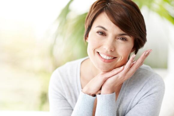 Smiling women with face in hands