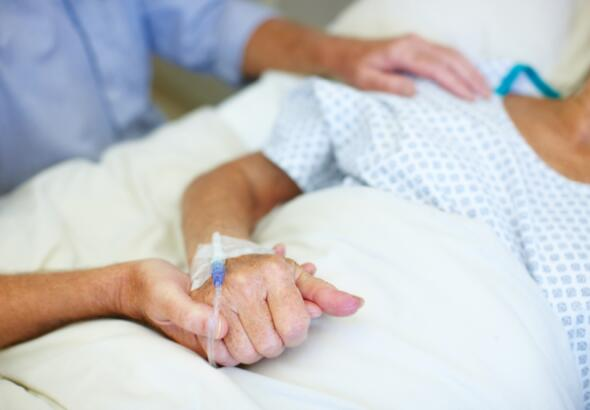 closeup of holding patient's hands