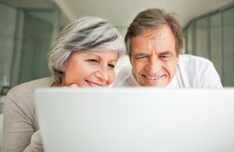 Couple viewing laptop