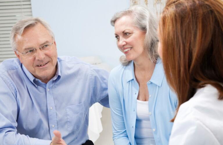 Mature Adult Couple In Conversation With Doctor