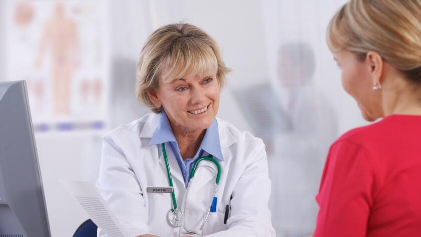 Women doctor talking with female patient