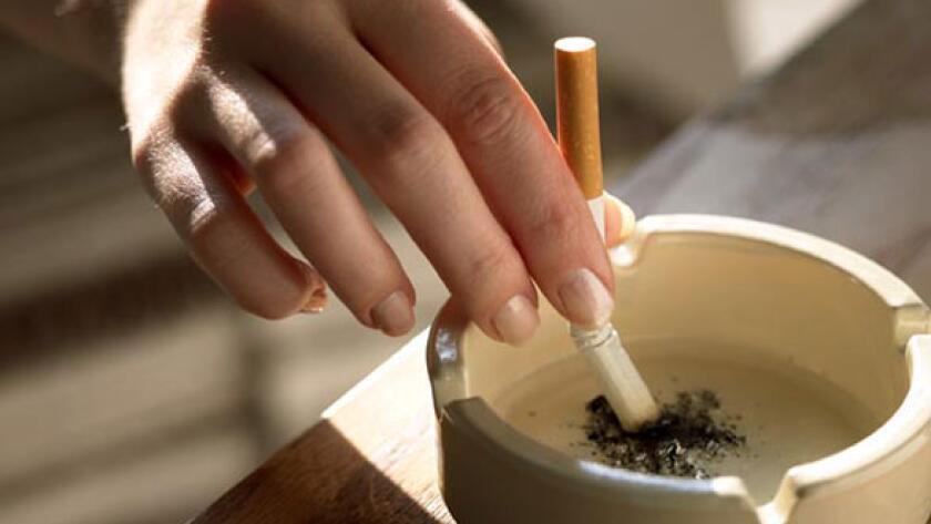 Stubbing out cigarette