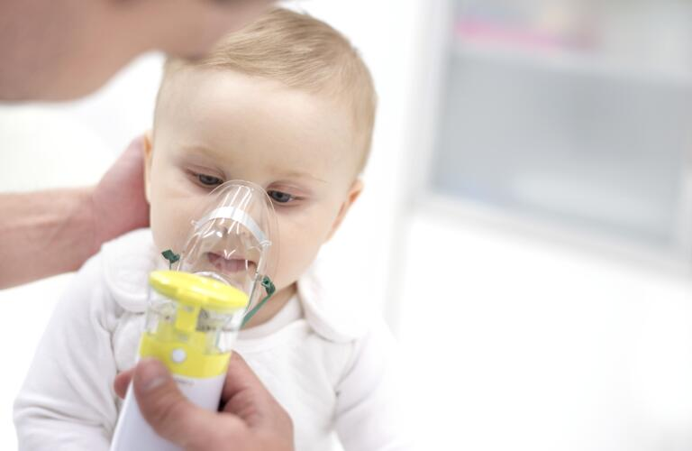 baby using nebulizer