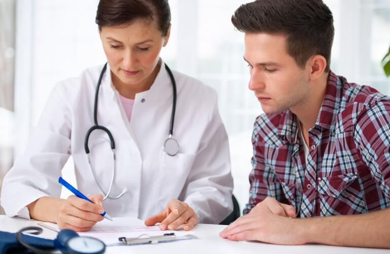 young male patient reviewing results with doctor