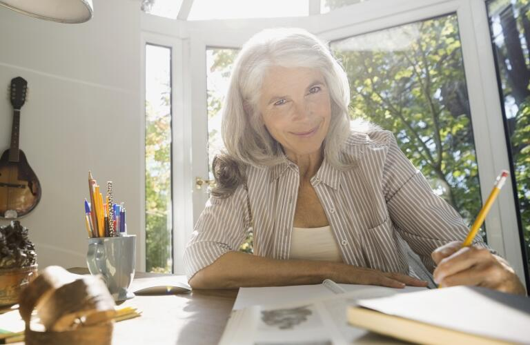 Older woman writing