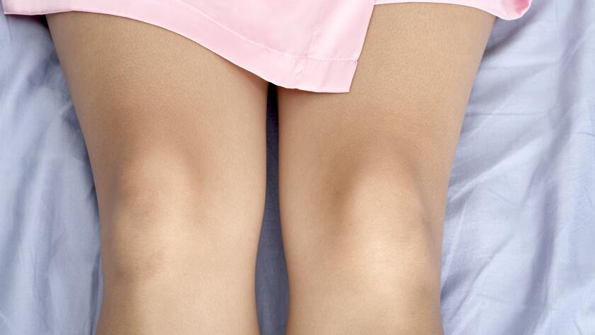 close-up-of-womans-knees