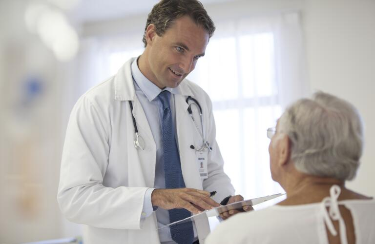 Senior patient and doctor