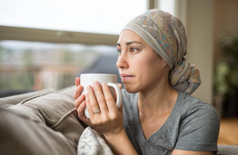 Cancer patient staring out of window