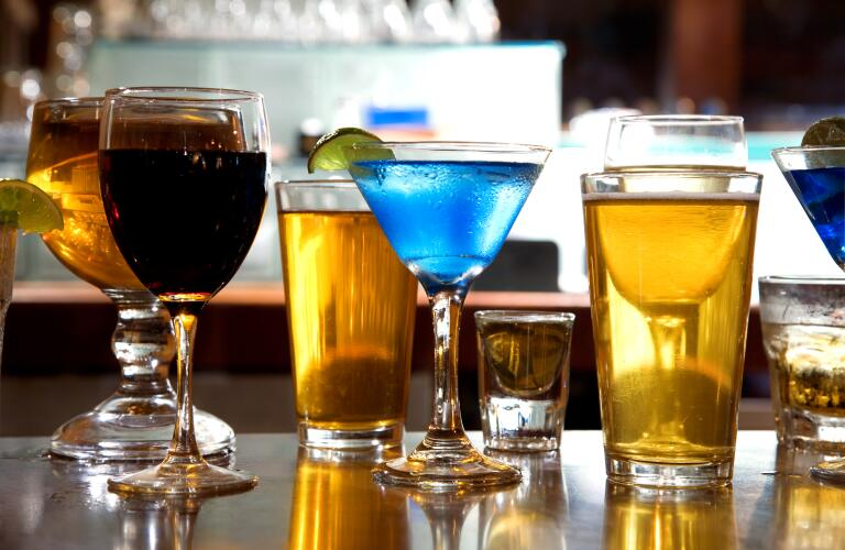 mixture of wine, liquor, beer glasses on bar