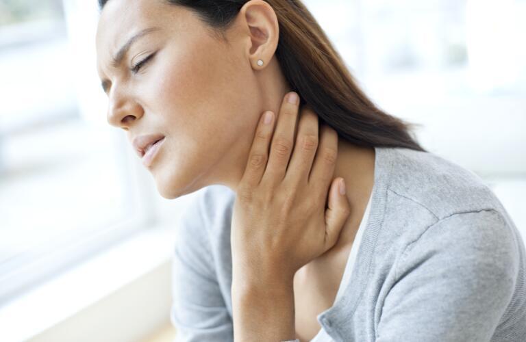 woman-touching-throat