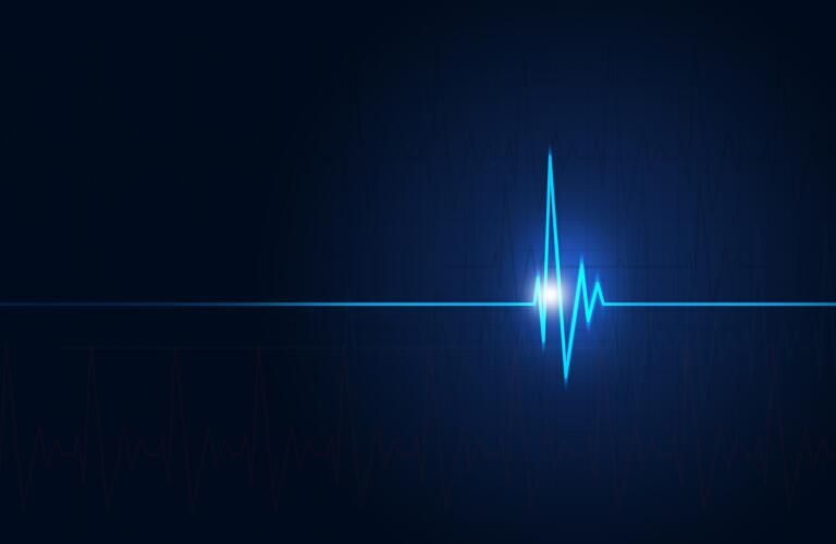 concept image of a heartbeat as seen by electrocardiogram on a medical blue background