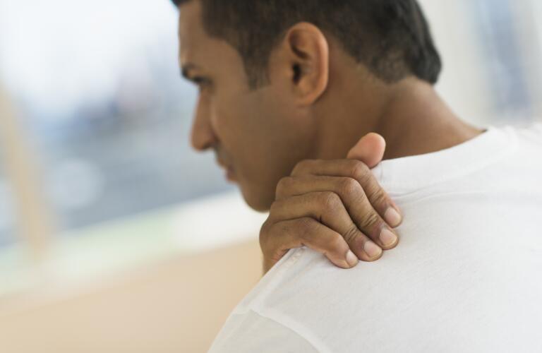 man-massaging-shoulder