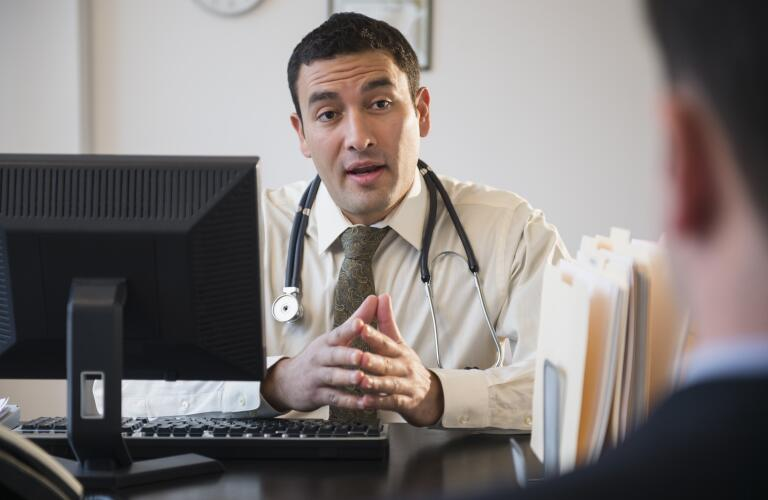 Doctor talking to clients in office
