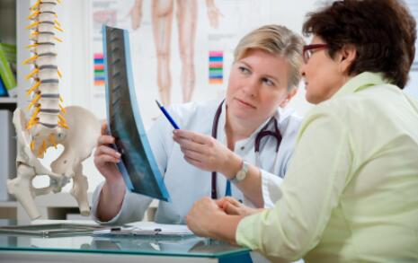 doctor discussing xray with patient