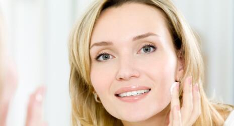 Women putting cream on face