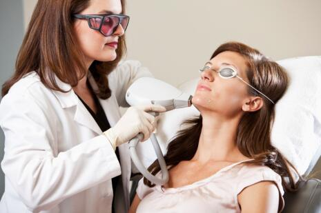 Female Specialist Performing Laser Hair Removal