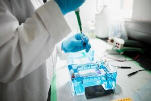 scientist-with-pipette-in-laboratory