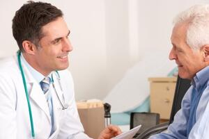 Male doctor talking to male patient