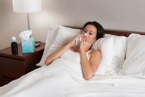Women sick in bed