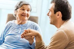 man talking with senior woman