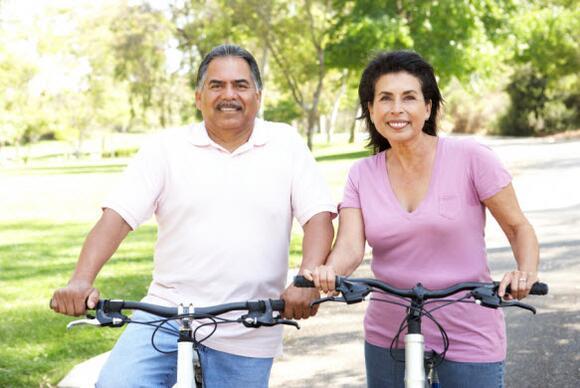 senior couple on bikes