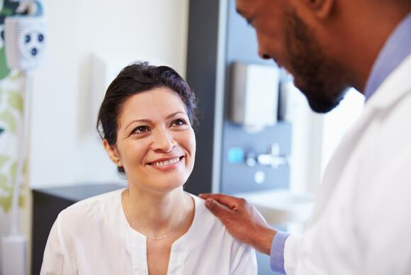 woman talking to male doctor