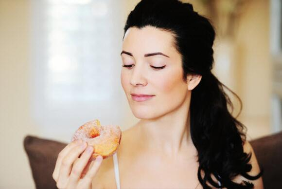 Woman eating doughnut