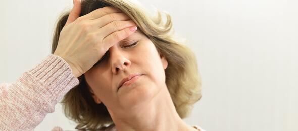 Woman With Headache Holding Hand on Head