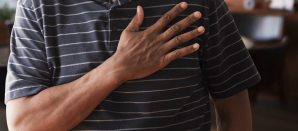 close up of black male touching heart