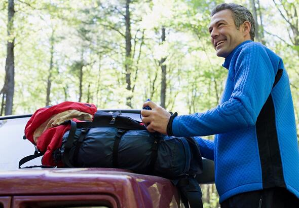 smiling middle aged man camping