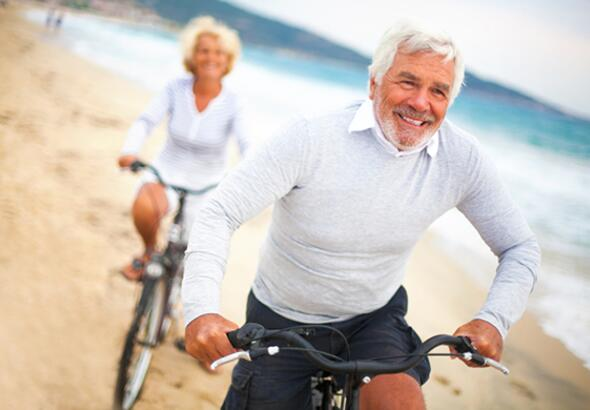 middle age couple biking