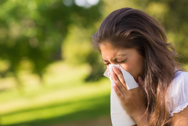 Woman Blowing Nose Allergies