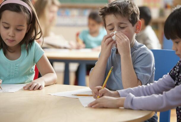 boy-blowing-nose-in-classroom