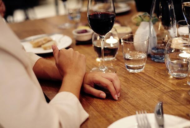 Friends having wine at restaurant