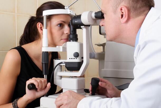 Eye doctor performing eye examination