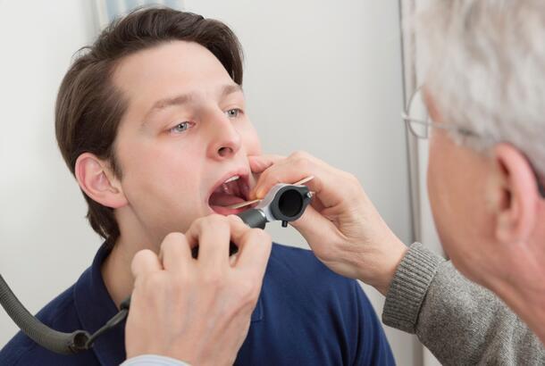 Throat Exam With Depressor