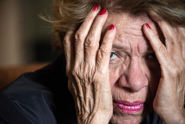 stressed elderly woman