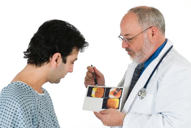 Doctor Explains Colonoscopy Images To Patient