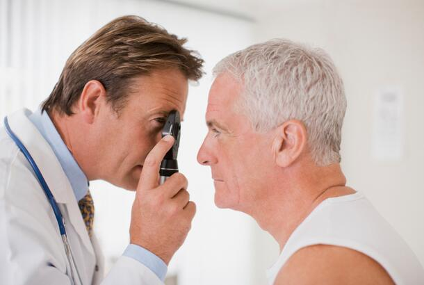 Doctor examining patients eyes