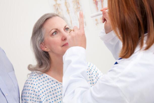 Doctor Giving Exam to Senior Woman