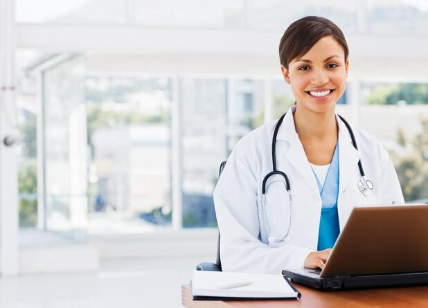Doctor sitting with a laptop