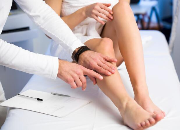 Doctor pointing at legs