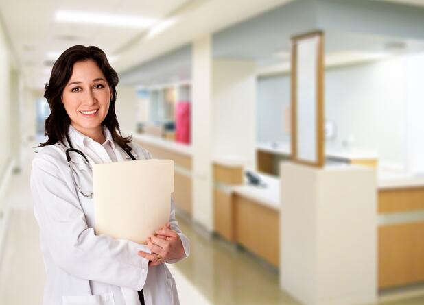 Doctor holding patient files