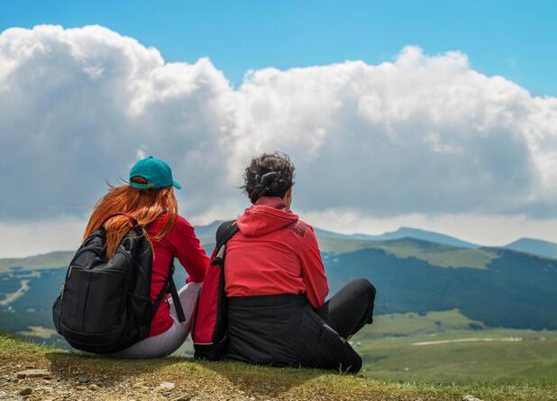 two women hiking in mountains