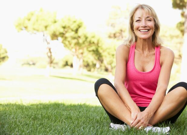 happy senior woman exercising outdoors