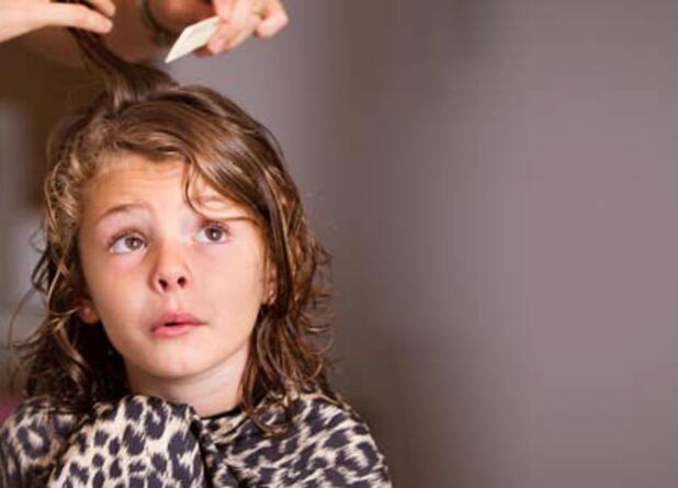 girl-getting-combed-for-head-lice